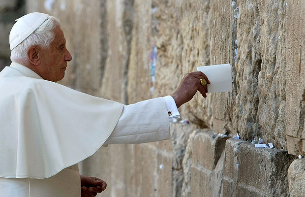 Pope Benedict XVI places a note   in the Western Wall, Judaism's holiest prayer site, in Jerusalem's Old   City May 12, 2009.